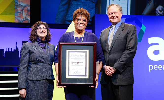 2016–17 ACRL President Irene M. H. Herold (l) and Senior Vice President and Chief Revenue Officer, GOBI Library Solutions from EBSCO Mark Kendall present the 2017 ACRL Academic/Research Librarian of the Year Award to Loretta Parham of the Atlanta University Center Woodruff Library.