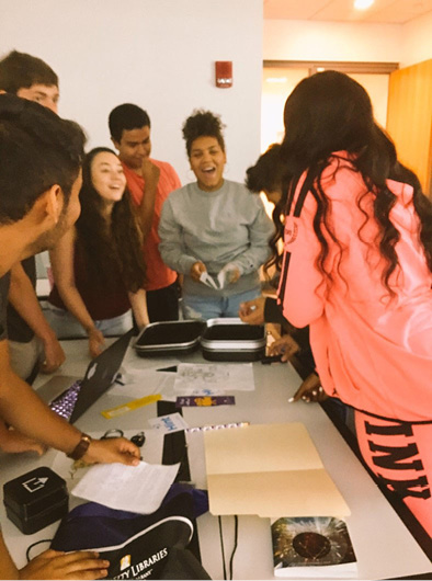 Figure 3. Students excitedly open the lock box to reveal the congratulatory message inside.