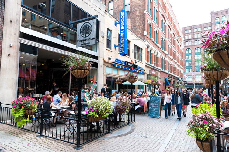 East 4th Street is home to many dining destinations, including Greenhouse Tavern, Lola, and Mabel's BBQ. Photo credit: ThisIsCleveland.com.