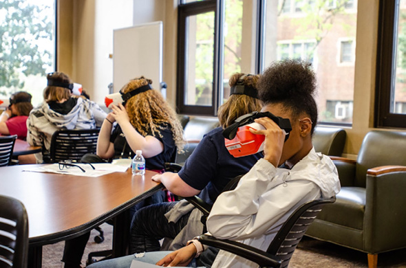 "Students participating in the workshop ""Virtual Reality: An Introduction to Total Immersion,"" presented by members from Oak Ridge National Laboratory."
