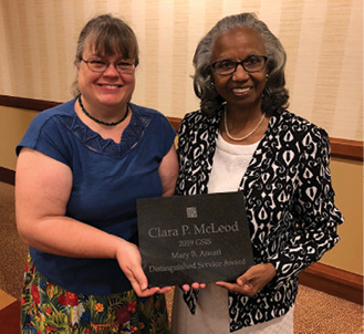 Clara McLeod (right), accepts the 2019 Mary B. Ansari Distinguished Service Award from Geoscience Information Society President Cynthia Prosser.