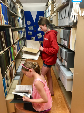 Campers examine materials in the Archives.