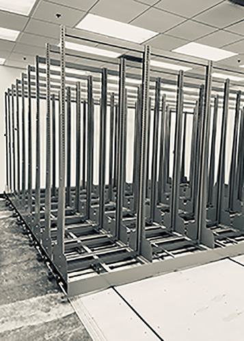 The Poetry Center's compact shelving project midway through installation. Photo by Sarah Kortemeier.