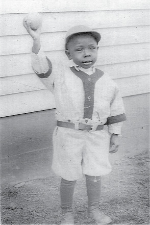 """Arville """"Baby"""" Riggins Jr., son of baseball shortstop in the Negro Leagues Arville """"Bill"""" Riggins of Colp, is pictured in his baseball uniform circa 1925.  From Ronald Kirby collection."""